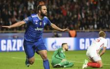 Gonzalo Higuain reacts after scoring a second goal during the Uefa Champions League semi-final first leg football match Monaco vs Juventus at the Stade Louis II stadium in Monaco on 3 May 2017. Picture: AFP.