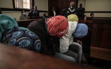 The four police officers who allegedly killed Mthokozisi Ntumba appeared in the Johannesburg magistrates court on 24 March 2021. Ntumba was shot and killed when police fired rubber bullets at protesting students in Braamfontein. Picture: Abigail Javier/Eyewitness News