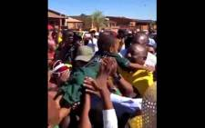 A screengrab of President Cyril Ramaphosa greeting a young girl in Khayelitsha.