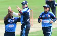 Titans players celebrate the fall of a wicket. Picture: @OfficialCSA/Twitter.