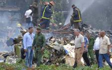 Cuban President Miguel Diaz-Canel (2-R, in khaki) is pictured at the site of the accident after a Cubana de Aviacion aircraft crashed after taking off from Havana's Jose Marti airport on May 18, 2018. Picture: AFP
