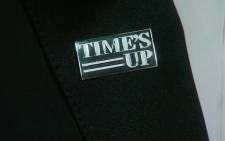 A screengrap of a Time's Up lapel badge.