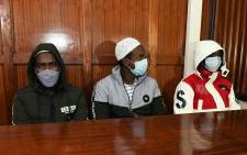 Terror suspects (L-R) Hassan Hussein Mustafa, Liban Abdullahi Omar, and Mohamed Ahmed Abdi who are charged with aiding the gunmen involved in the Westgate Mall attack of September 2013, sit in the dock during their appearance for their case at the Milimani court in Nairobi on 6 October 2020. Picture: AFP