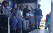 Police Minister Bheki Cele watches a parade by members of a tactical police unit at the Westbury sports ground on 4 October 2018. Picture: @SAPoliceService/Twitter