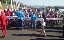 Riders gather at the Momentum 94.7 Cycle Challenge on 17 November 2013. Picture: @danmoyane/Twitter.
