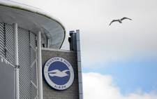 FILE: A gull flies past the stadium ahead of the English Premier League football match between Brighton and Hove Albion and Manchester City at the American Express Community Stadium in Brighton, southern England on 12 August 2017. Picture: AFP.
