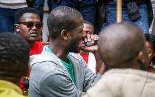 FILE: A CPUT Fees2017 protester sings with the crowd waiting for a general assembly to begin. Picture: Anthony Molyneaux/EWN