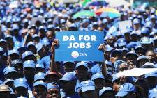 A DA member holds up a placard during the party's march against unemployment through Johannesburg's CBD on 27 January 2016. Picture: Reinart Toerien/EWN.