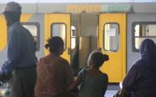 Commuters wait to board a Metrorail train. Picture: Eyewitness News