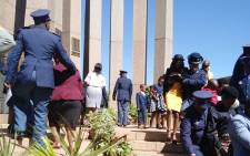SAPS members console family members of slain police officers during a commemoration day event on 1 September 2019. Picture: @SAPoliceService/Twitter.