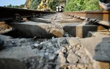 Damaged railroad tracks are seen at the location where a packed train collided with a vehicle on the tracks and then derailed inside a tunnel in the mountains of Hualien, eastern Taiwan on April 3, 2021. Picture: Sam Yeh / AFP.