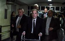 FILE: Harvey Weinstein walks away from the courtroom in New York City criminal court on 6 January 2020 in New York City. Picture: AFP