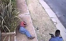 A screengrab from a video showing a police officer shooting criminal Khulekani Mpanza in Krugersdorp.