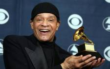 Singer Al Jarreau posing with his trophy at the 49th Grammy Awards in Los Angeles . Al Jarreau, famed R&B and jazz singer died on 12 February, 2017. Picture: AFP.