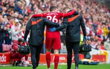 Liverpool defender Andy Robertson is helped off the field after picking up an injury during the friendly match against Athletic Bilbao on 8 August 2021. Picture: @LFC/Twitter