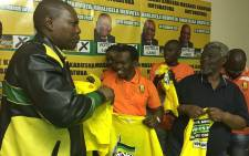 NFP in KZN members receive ANC T-shirts after announcing that they'll vote for the ruling party on 3 August. Picture: @MYANC via Twitter.