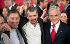 FILE: Rescued miners Mario Sepulveda and Luis Ursua, Spanish actor Antonio Banderas and Chilean President Sebastian Pinera pose at La Moneda presidential palace in Santiago on January 31. Picture: AFP.