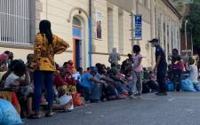 Foreign nationals a few metres from Cape Town's Central Police Station. They say most people no longer have the accommodation they had four months back, and because they have nowhere to go they might as well be arrested. Picture: Kaylynn Palm/EWN