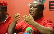 Economic Freedom Fighters leader Julius Malema briefed the media in Johannesburg on 04 February 2016 on President Jacob Zuma's claims that he will pay back some of the money spent on upgrades to his Nkandla homestead. Picture: Christa Eybers/EWN.