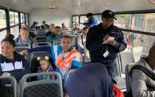 Bus enforcement unit officers on a bus from Mitchells Plain to Cape Town. Since the launch last month, they've checked more 3,000 buses. Picture: Kaylynn Palm/EWN