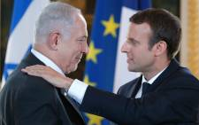 French President Emmanuel Macron and Israeli Prime Minister Benjamin Netanyahu give a joint press conference at the Elysee Palace in Paris, on 16 July, 2017. Picture: AFP.