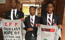 Three Maritzburg College pupils holding EFF-branded T-shirts on the school premises. Picture: @tumisole/Twitter