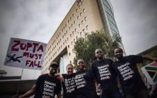 Anti-President Jacob Zuma protesters march through Sandton central holding anti-Zupta placards. Picture: Thomas Holder/EWN.