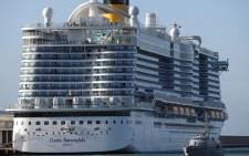 FILE: A Guardia di Finanza boat patrol around the 'Costa Smeralda' cruise ship docked in the Civitavecchia port 70km north of Rome on 30 January 2020. More than 6,000 tourists were under lockdown aboard the cruise ship after two Chinese passengers were isolated over fears they could be carrying the coronavirus. Picture: AFP.