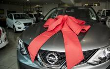 A Nissan vehicle is covered with a ribbon at the Mark White Nissan dealership in Fourways, Johannesburg. Picture: Reinart Toerien/EWN