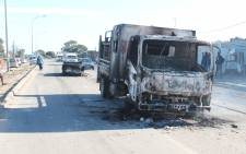 A City of Cape Town maintenance truck was hijacked and torched in Delft on 3 June 2021. Picture: Nqobile Simelane, COCT
