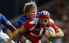 Renaldo Bothma of Namibia tackles Merab Sharikadze of Georgia during the 2015 Rugby World Cup Pool C match between Namibia and Georgia at Sandy Park on 7 October, 2015 in Exeter, United Kingdom. Picture: Rugby World Cup Facebook page.