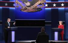 Republican presidential nominee Donald Trump (left) speaks as Democratic presidential nominee Hillary Clinton (right) and moderator Lester Holt (centre) listen during the presidential debate at Hofstra University on 26 September 2016 in Hempstead, New York. Picture: AFP.