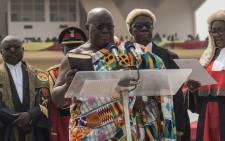 The winner of Ghana's presidential election Nana Akufo-Addo takes the oath of office during the swearing-in as elected President of the fourth Republic of Ghana, in Independence Square in the capital Accra, on 7 January, 2017. Picture: AFP.