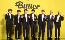 FILE: Members of South Korean K-pop boy band BTS pose for photographs during a press conference to promote their new single album 'Butter' in Seoul on 21 May 2021. Picture: Dong-A Ilbo/AFP