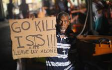 FILE:  Fred Scott joins other demonstrators protesting the killing of teenager Michael Brown on 20 August, 2014 in Ferguson, Missouri. Picture: AFP