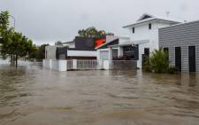 Houses sit in Townsville's floodwaters on 4 February 2019, as the recent downpour in Australia's tropical north has seen some areas get a year's worth of rainfall in a week. Picture: AFP