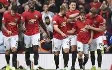 Manchester United's Daniel James (2nd R) celebrates with teammates after scoring their fourth goal on his premier league debut during the English Premier League football match between Manchester United and Chelsea. Picture: AFP.