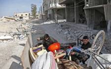 Syrians pack their belongings as they flee their home in the town of Utaya in the Syrian rebel enclave of Eastern Ghouta on 1 March 2018.  Picture: AFP.
