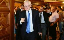 FILE: Russian Deputy Foreign Minister Sergei Ryabkov leaves at the end of a press conference on 28 June, 2014 in Damascus. Picture: AFP