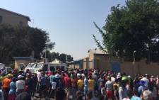 Westbury community members have gathered outside the Sophiatown Police Station calling for corrupt police officers to be removed. Picture: Ahmed Kajee/EWN