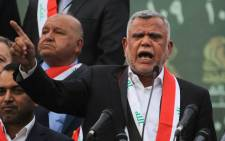 FILE: Hadi al-Amiri, head of the Iranian-backed Badr Organization and leader of the Fateh Alliance, a coalition of Iranian-supported militia groups, speaks during a campaign rally in Baghdad on 7 May 2018, ahead of Iraq's parliamentary elections to be held on May 12. Picture: AFP