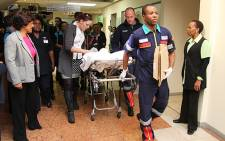 Netcare 911 paramedics wheel Pippie Kruger out of Garden City Hospital on 4 July 2012. Picture: Taurai Maduna/EWN
