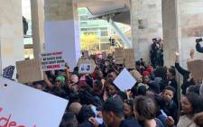 Anti-gender violence protesters at the CTICC in Cape Town where the WEF Africa event is being held on 4 September 2019. Picture: Christa Eybers/EWN