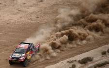 Toyota's driver Giniel De Villiers of South Africa and co-driver Dirk Von Zitzewitz of Germany compete during Stage 11 of the 2017 Dakar Rally between San Juan and Rio Cuarto, in Argentina, on 13 January 2017. Picture: AFP