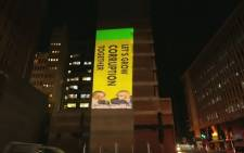 The DA projects its elections message on the ANC's Luthuli House headquarters. Picture: EWN