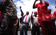 Julius Malema and Economic Freedom Fighters outside the Polokwane High Court. Picture: Barry Bateman/EWN.