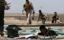 Iraqi Kurdish forces take position as they fight jihadist militants from the Islamic State of Iraq and the Levant (ISIL) on 29 June 2014. Picture: AFP.