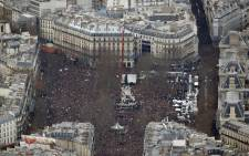 Aerial view taken on  11 January, 2015 shows people attending the Unity rally Marche Republicaine at the Place de la Republique (Republiques square) in Paris in tribute to the 17 victims of a three-day killing spree by homegrown Islamists. Picture: AFP.