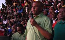 Amcu leader Joseph Mathunjwa addresses hundreds of striking mineworkers after the union came a step closer to reaching a wage deal with platinum producers, Marikana, 12 June 2014. Picture: Reinart Toerien/EWN.