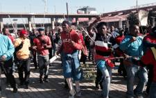 FILE: NUmsa members during strike action in Johannesburg on 1 July 2014. Picture: Sebabatso Mosamo/EWN.